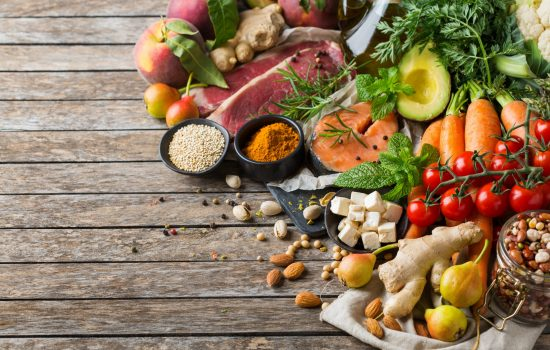 Balanced nutrition concept for clean eating flexitarian meditteranean diet. Assortment of healthy food ingredients for cooking on a wooden kitchen table.